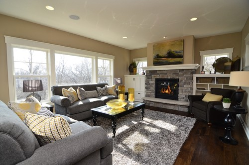 I like how you mix the beige walls with grey furniturewhat - grey and beige living room