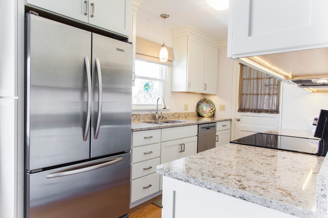 White Painted Shaker Galley Kitchen With Quartz Countertops