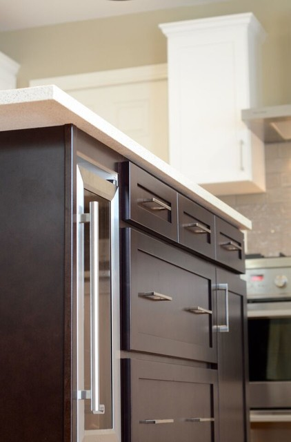 Cabinet refacing done in maple with a satin white finish