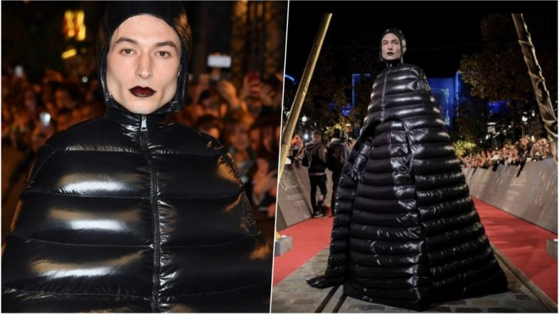 Ezra Miller Walks In A Shiny Puffer Coat At The Red Carpet