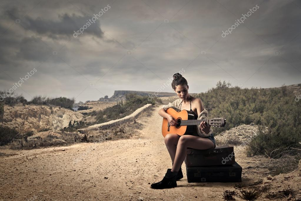 Lonely Girl Walking Wallpaper Girl Playing Guitar On A Dusty Road Stock Photo 169 Olly18