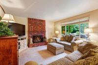 Cozy living room with brick fireplace  Stock Photo ...