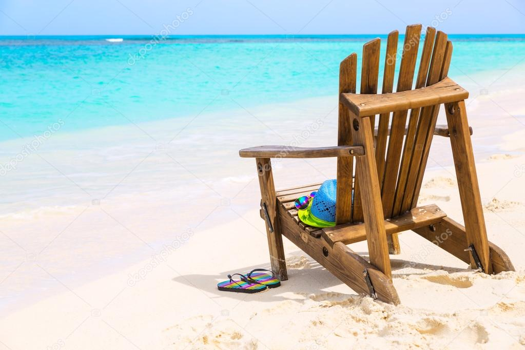 Wooden Beach Chair With Hat And Slippers At Beach Cost