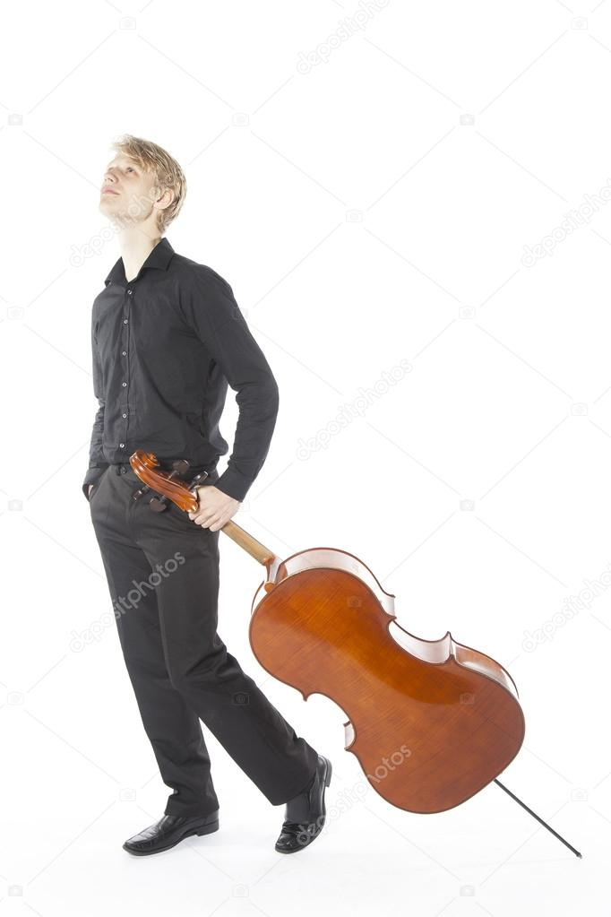 young blond caucasian man drags cello in studio against white ba - ba stands for