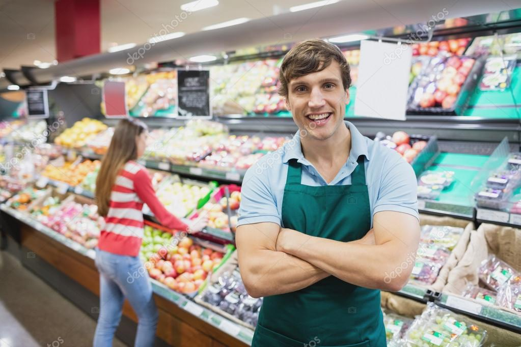 Shop assistant posing with arms crossed \u2014 Stock Photo - shop assistan
