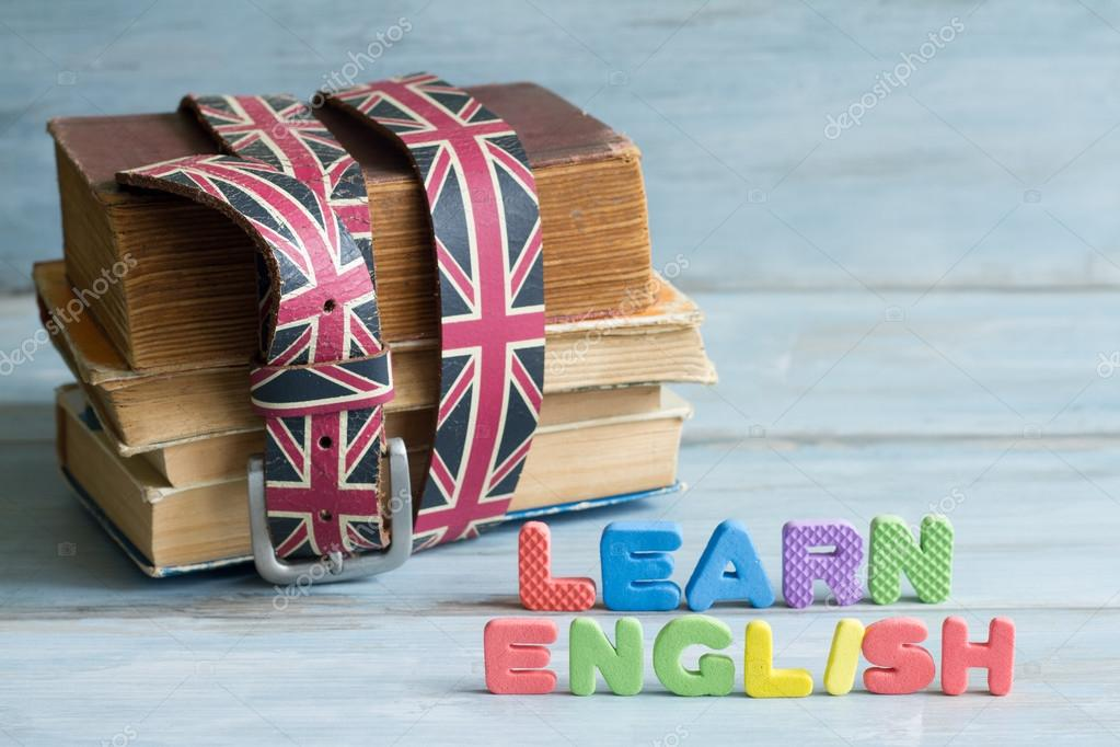 Learn English education concept with books and letters \u2014 Stock Photo