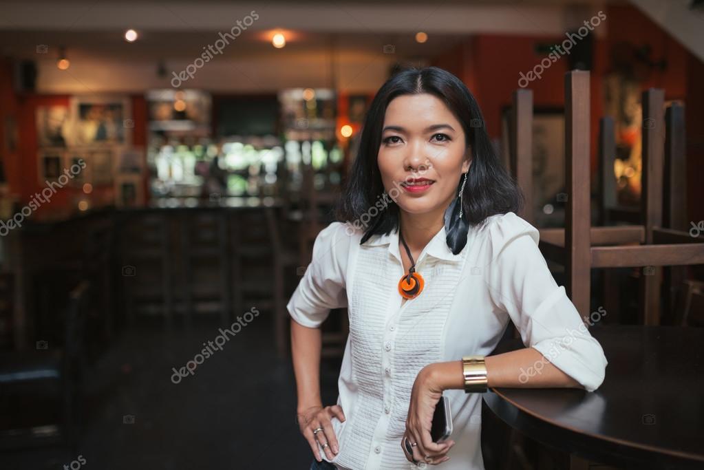 Female bar manager \u2014 Stock Photo © DragonImages #77070383