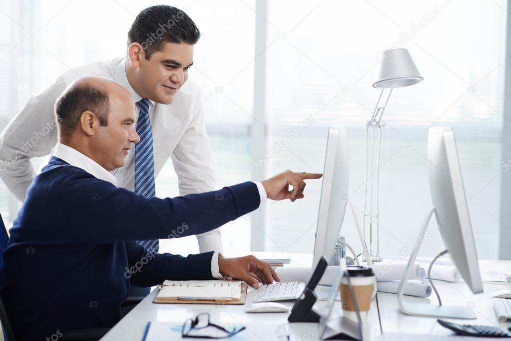 Helping new coworker \u2014 Stock Photo © DragonImages #96307268