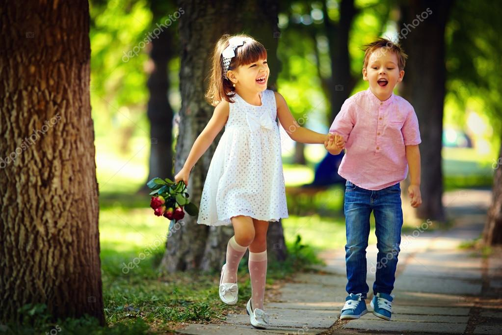 Cute Stylish Child Girl Wallpaper Cute Kids Walking Together In Summer Park Stock Photo