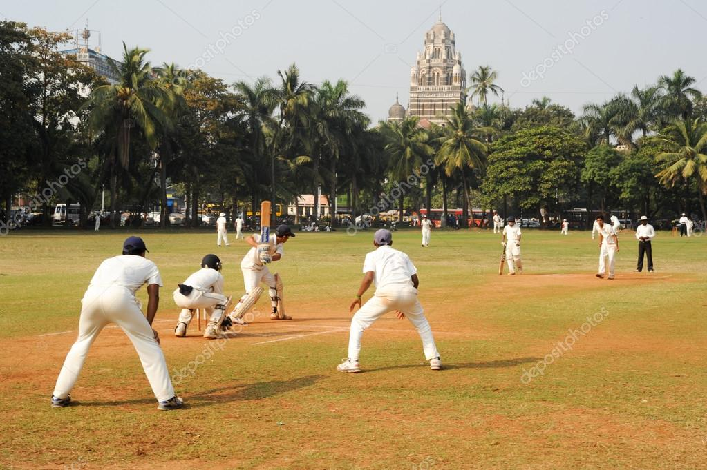 People playing cricket in the central park at Mumbai \u2013 Stock
