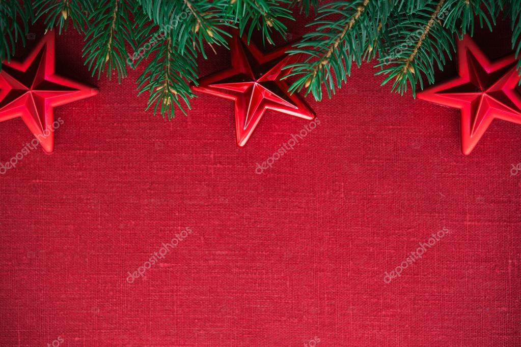 Frame with xmas tree and ornaments on red canvas background Merry - christmas theme background
