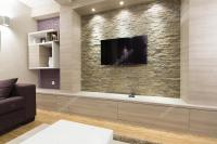 Modern living room interior - TV on brick wall  Stock ...
