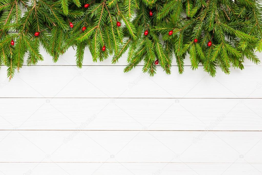 Christmas background Christmas fir tree on white wooden board