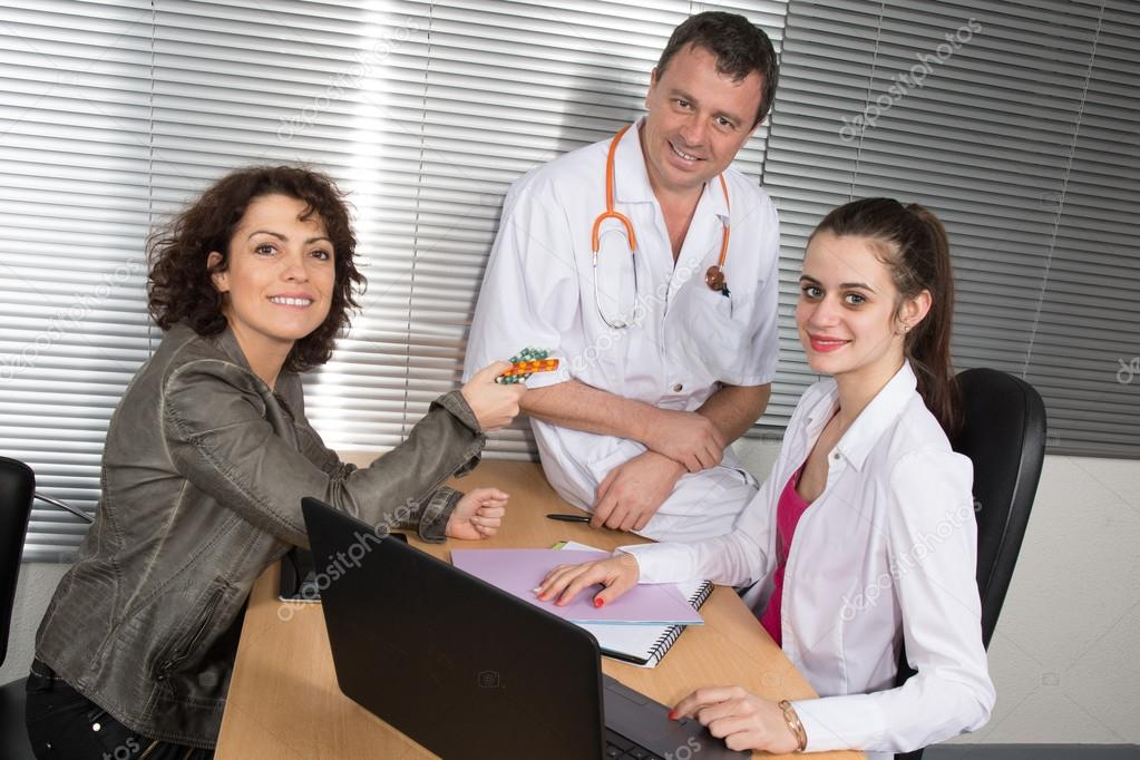 Woman Pharmaceutical Sales Representative with two doctors \u2014 Stock