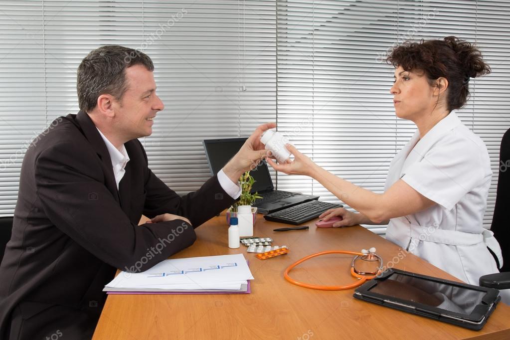 Doctor receiving a woman Pharmaceutical Sales Representative \u2014 Stock