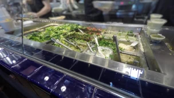 Food servers preparing a salad \u2014 Stock Video © jakerbreaker #70429407
