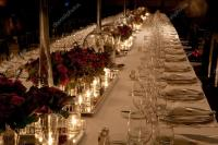 Elegant candlelight dinner table setting at reception ...