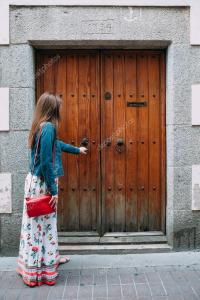 Girl knocking at the door  Stock Photo  Kostyazar #76798897