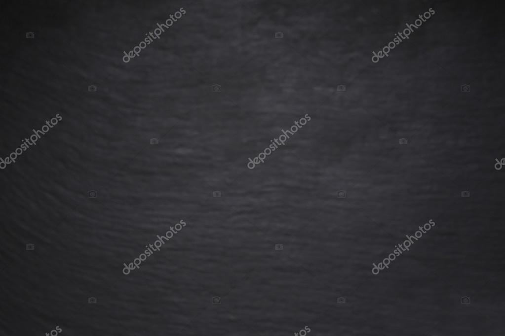 Black scratched grunge stucco wall background or texture \u2014 Stock