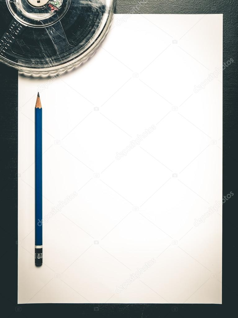 Movie Film writing with pencil on blank paper background \u2014 Stock