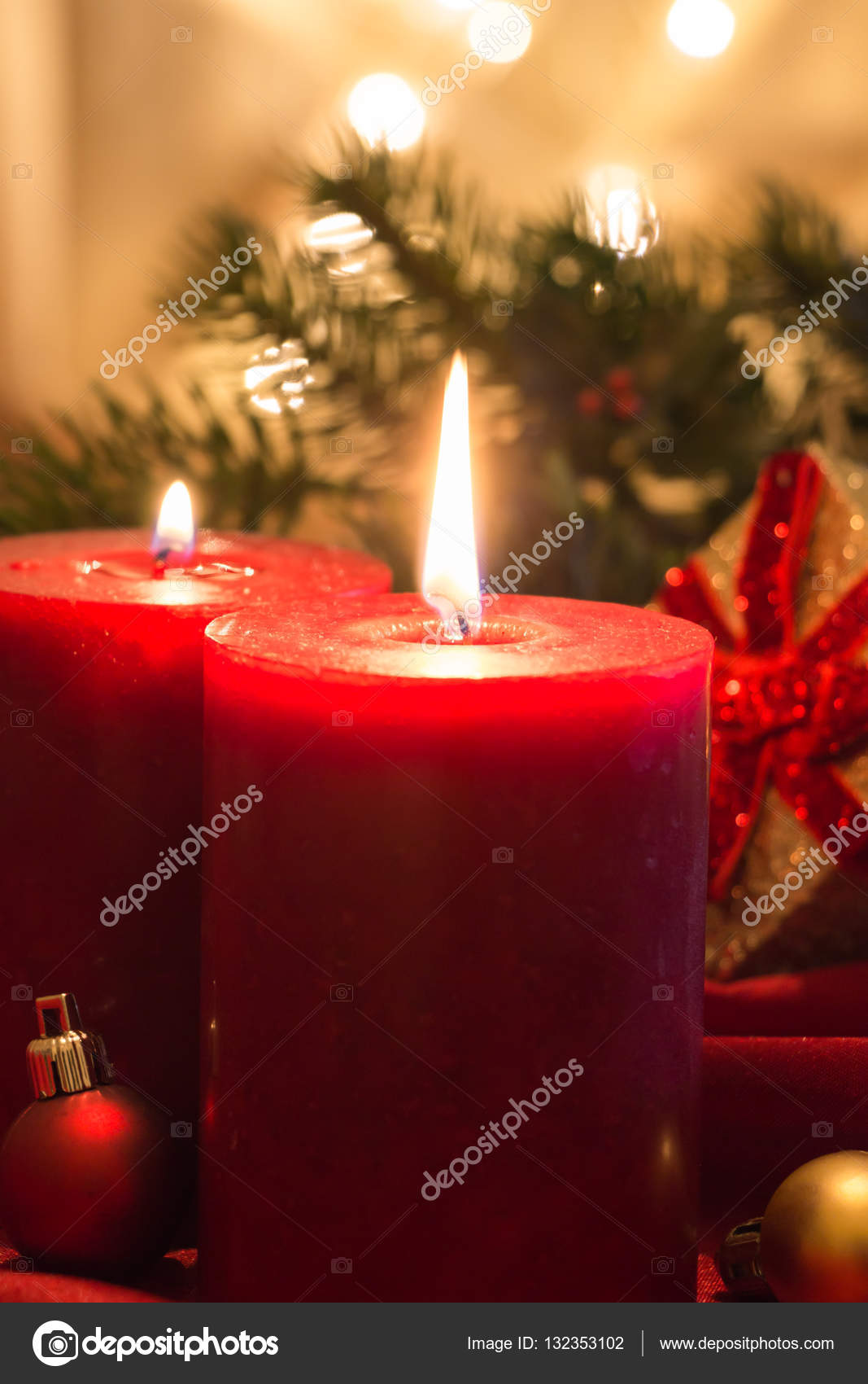 Lit Fabric Lit Red Candles With Christmas Balls On Red Fabric And Golden