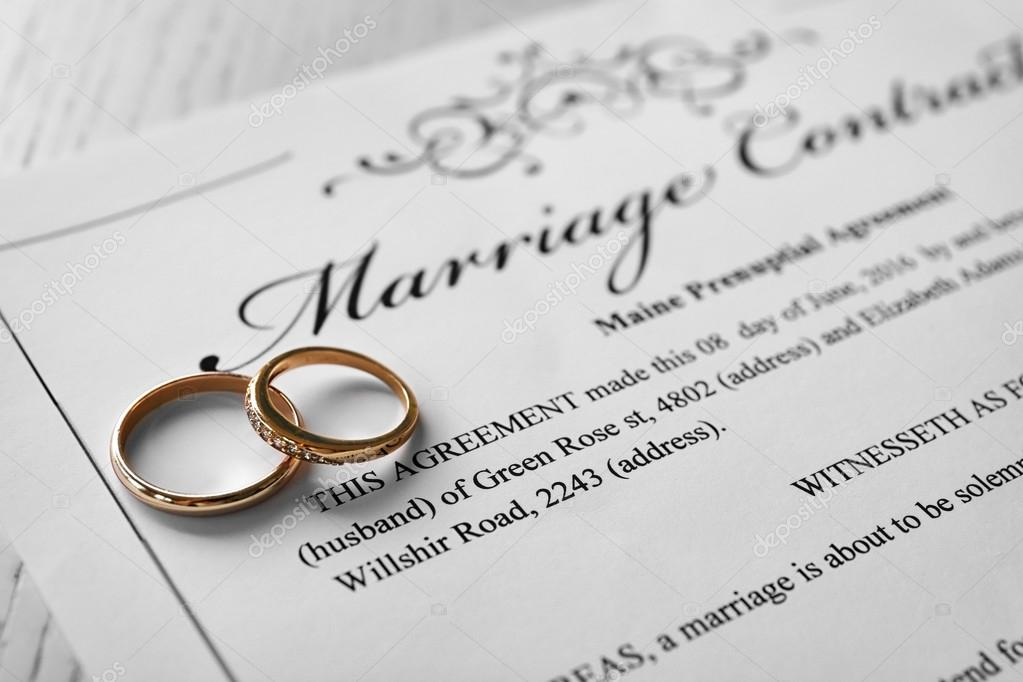 Golden wedding rings on marriage contract, closeup \u2014 Stock Photo - marriage contract