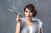 woman smoking with cigarette holder  Stock Photo ...
