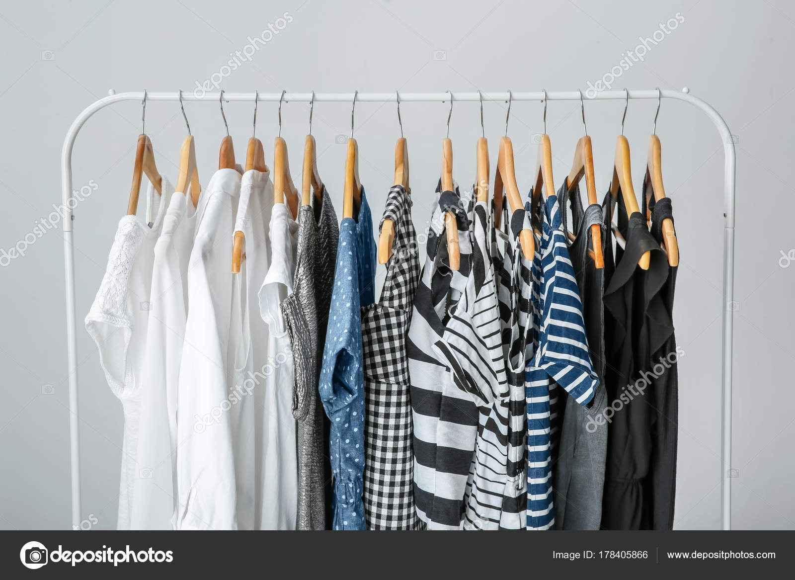 Stylish Clothes Stylish Clothes Hanging On Wardrobe Stand Stock Photo