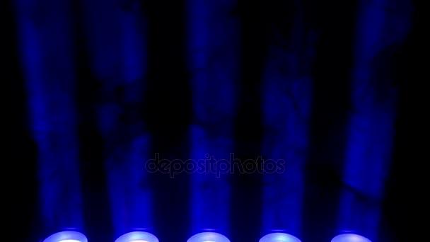 Blue spotlight and smoke on black background Abstract dark
