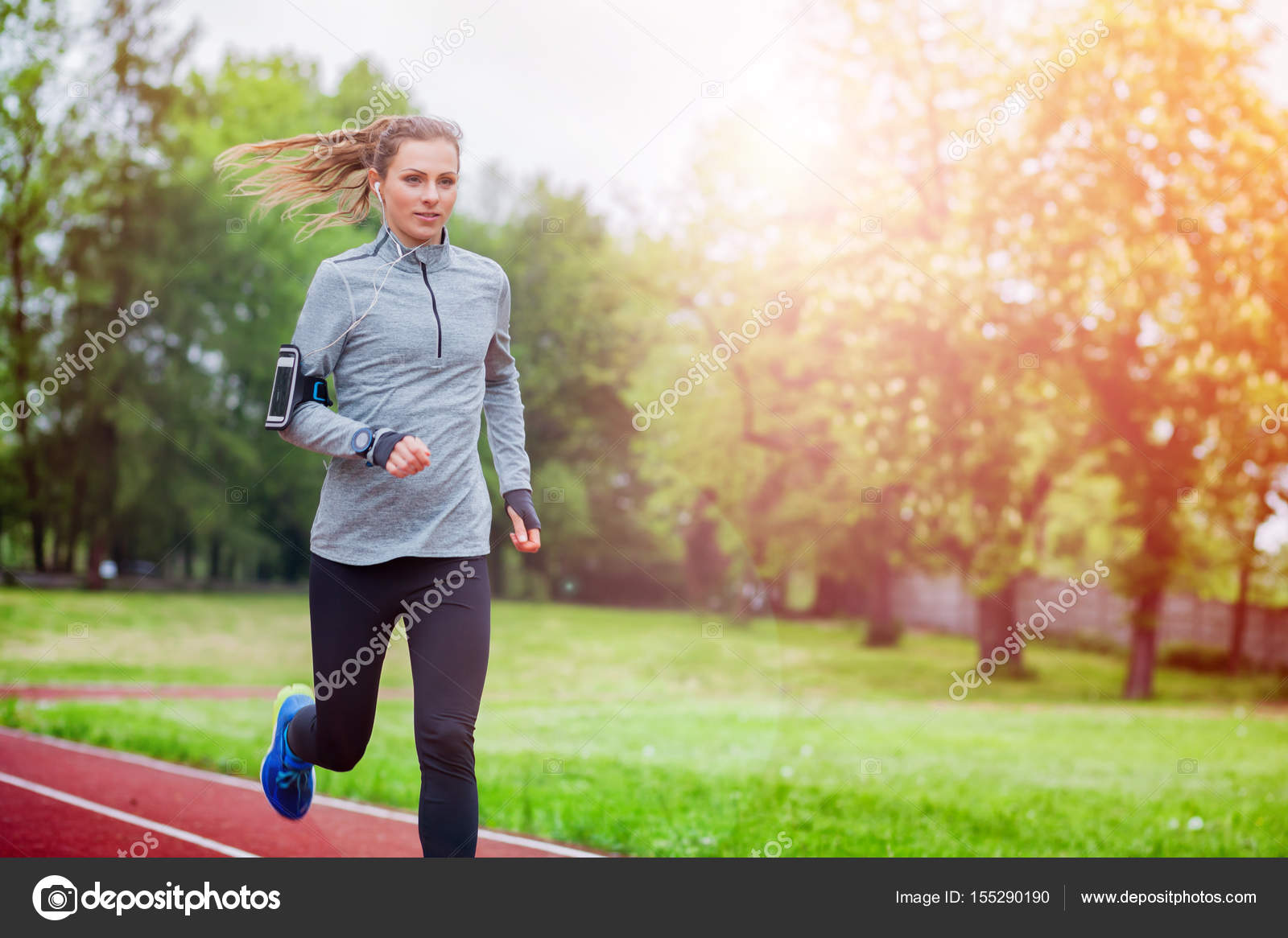 Running Jogging App Athletic Woman Running On Track With Smart Phone App And