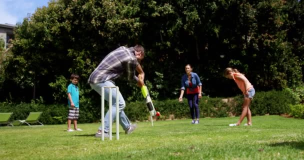 Happy family playing cricket \u2014 Stock Video © Wavebreakmedia #145088375