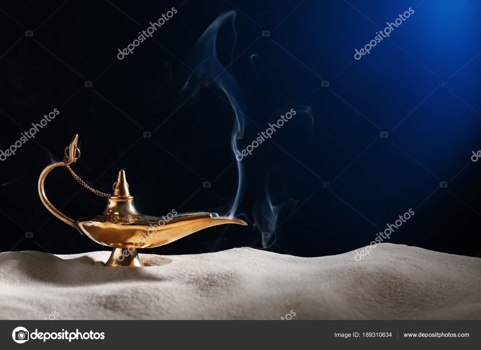 Chaise Aladin Aladdin Magic Lamp On Sand Against Dark Background Stock Photo