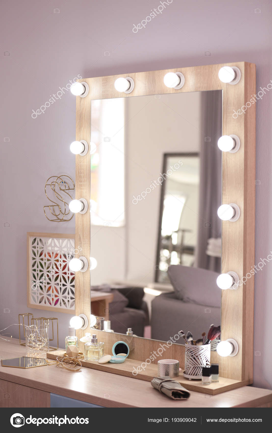 Cosmetic Table Mirror With Light Bulbs And Cosmetic Products On Dressing Table