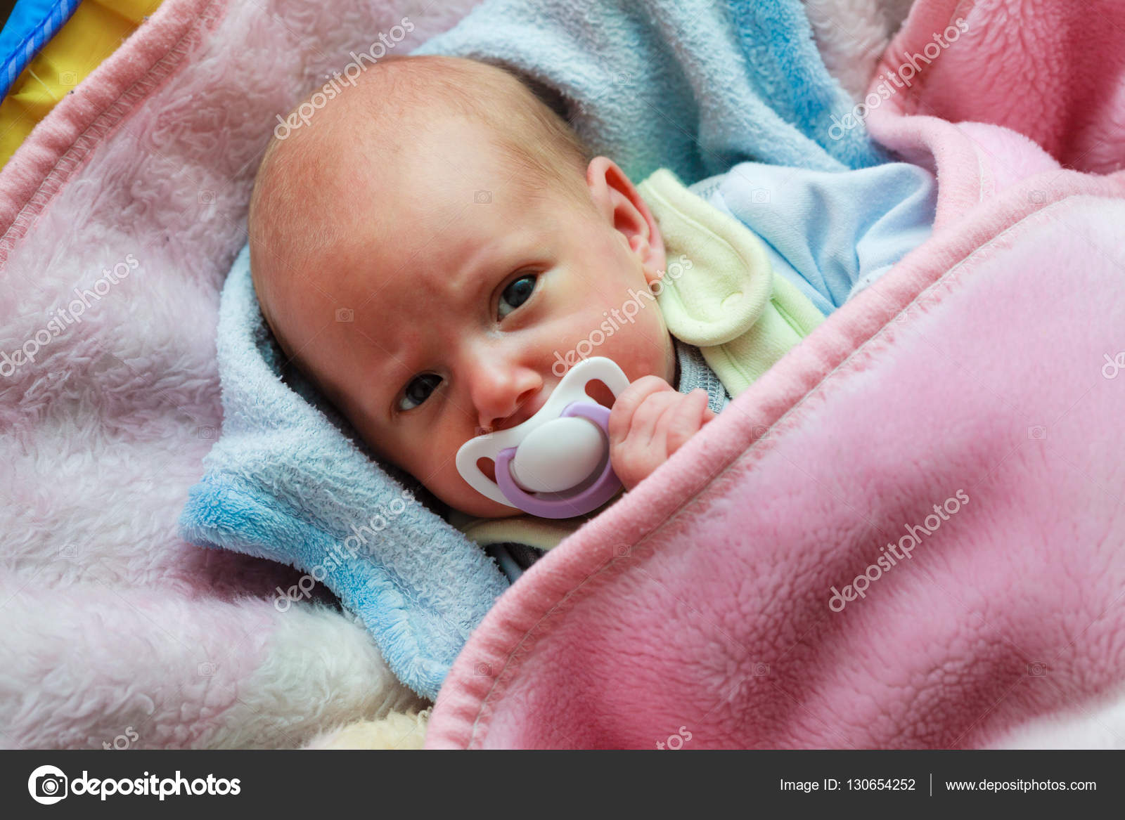 Newborn Babies For Dummies Newborn Baby Lying In Bed With Dummy Stock Photo