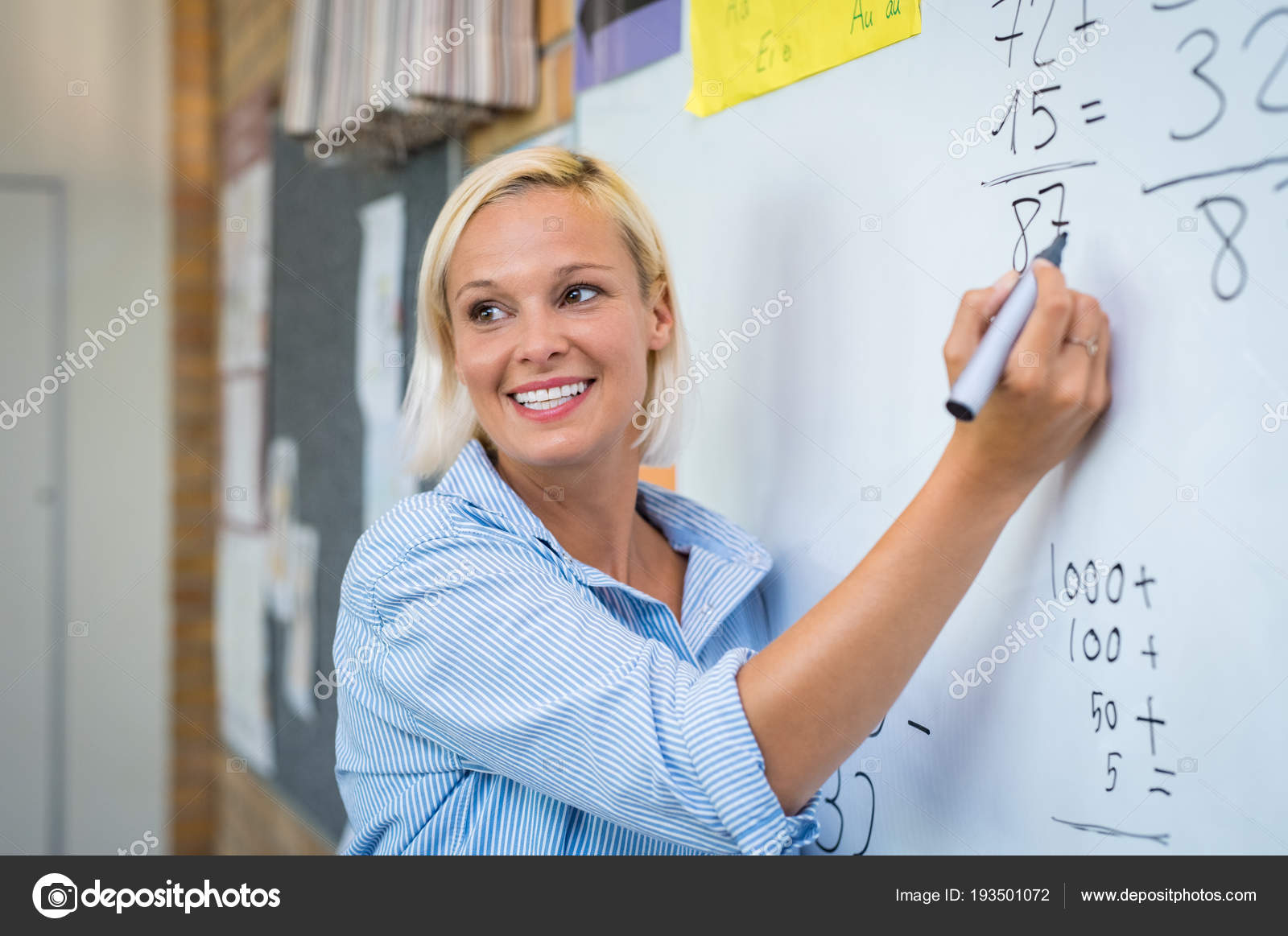 Teaching Maths Teacher Teaching Math On Whiteboard Stock Photo Ridofranz