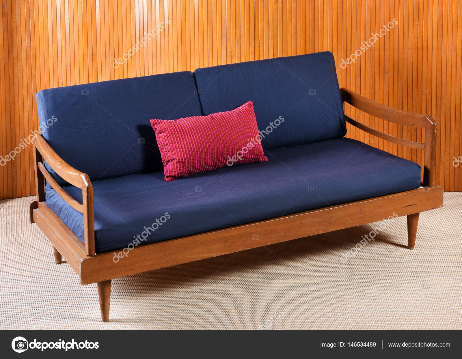 Retro Cushions Retro Sofa With Navy Blue Cushions In Living Room Stock Photo