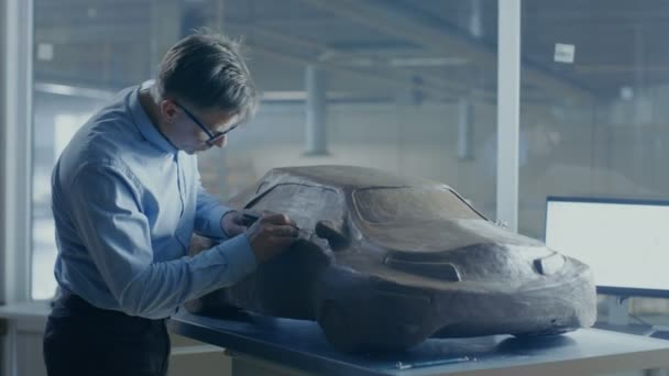 Grey Haired Automotive Designer Sculpts Futuristic Car Model from