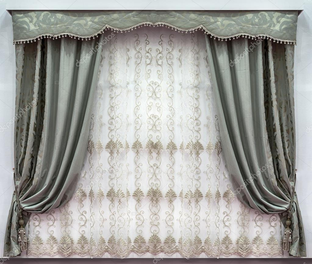 The Stylish Design Of The Windows In The Interior Combined Curtains Made Of The Natural Fabrics A Hard Pelmet And A Tulle With Embroidery Stock Photo Image By Fotiy 125058850