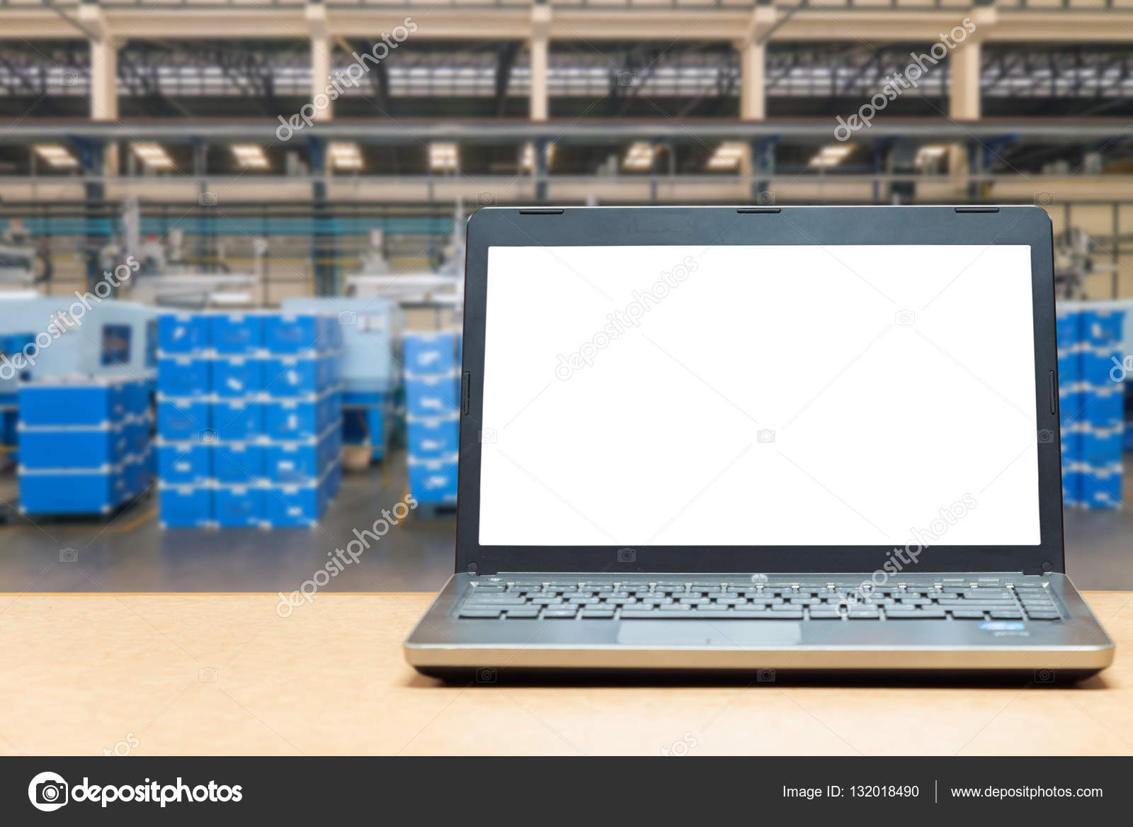 Warehouse Table Laptop With Blank Screen On Table With Blur Warehouse Cargo In F