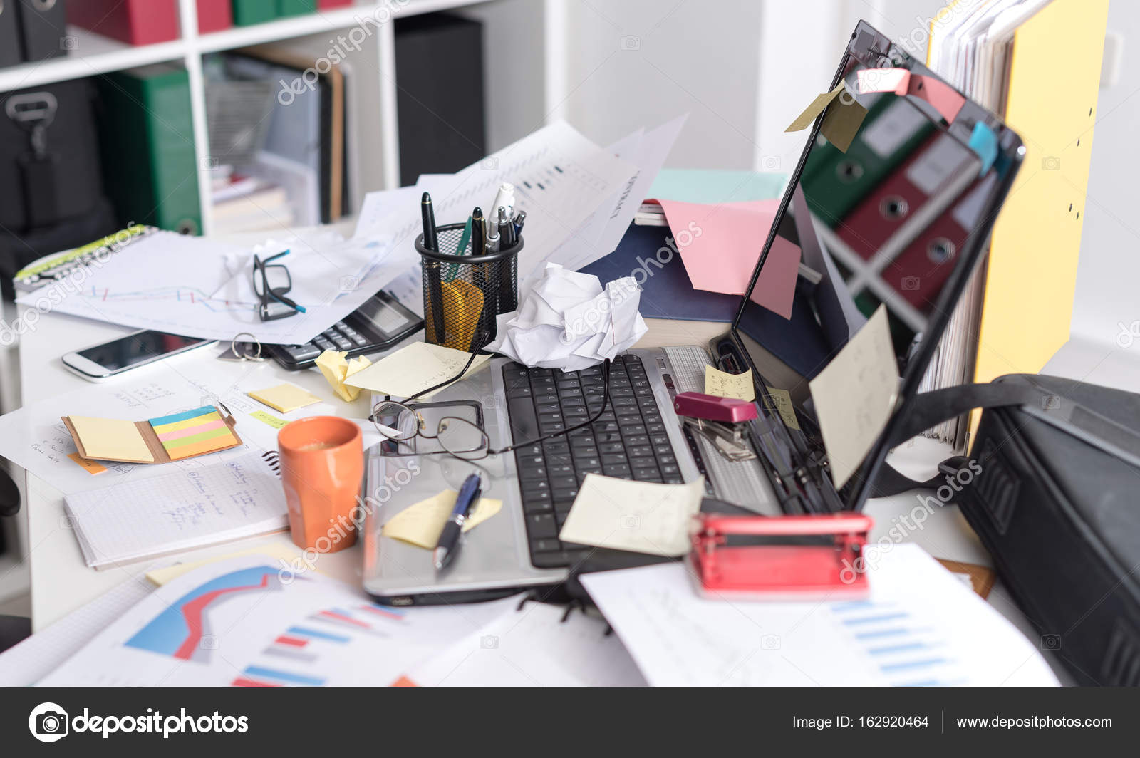 Clean Desk Policy Messy And Cluttered Desk — Stock Photo © Thodonal #162920464