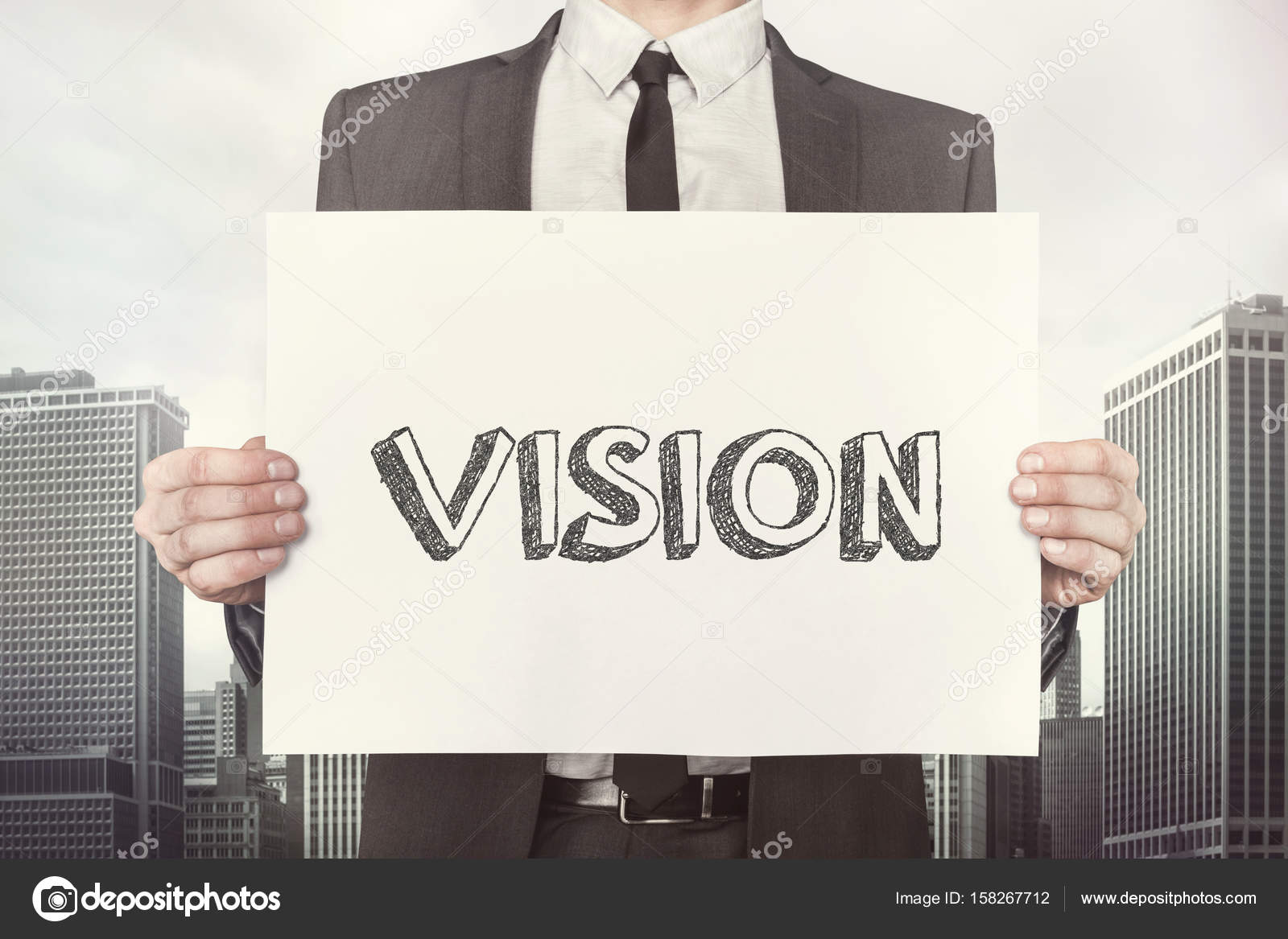 Placard Crossword Businessman Holding Vision Placard While Standing Against