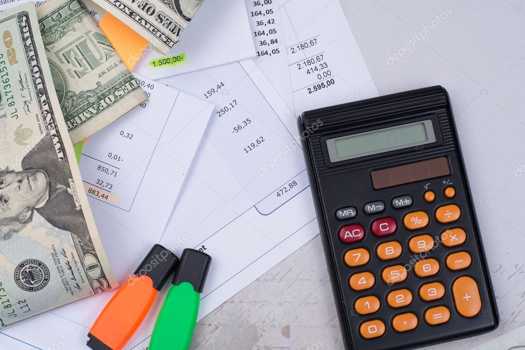 Utility or mortgage bills, calculator and US dollars - finance