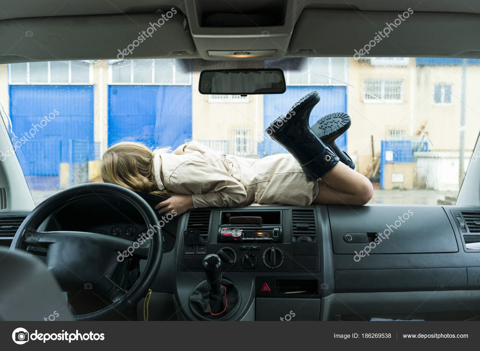 Toddler Car Dashboard Toddler Laying On Dashboard Of Van Stock Photo