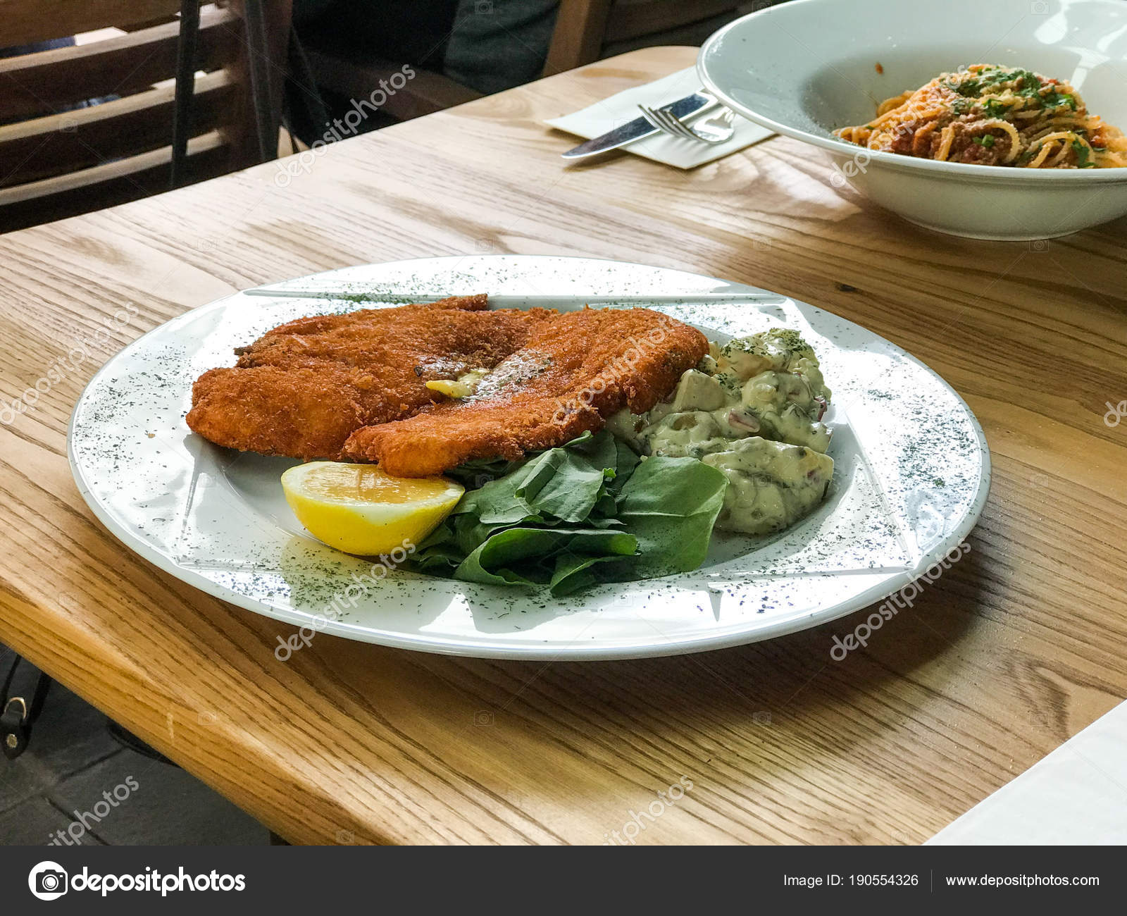Schnitzel Restaurant Chicken Schnitzel With Potato Salad And Lemon Served At Restaurant
