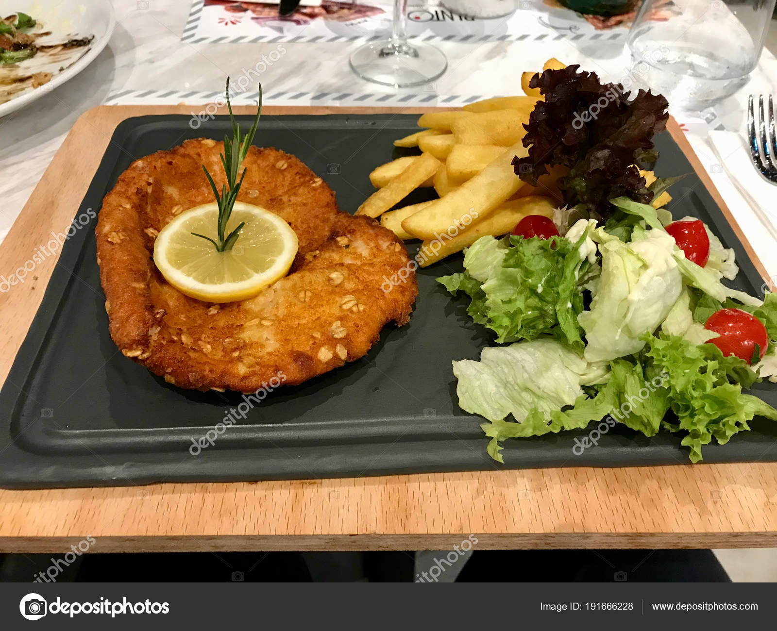 Schnitzel Restaurant Chicken Schnitzel With Lemon Salad And Potatoes Served At
