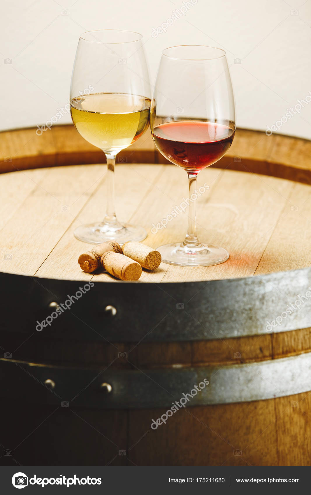 Small Wine Stand Glasses Of White And Red Wine Stand On Wooden Barrel Stock Photo