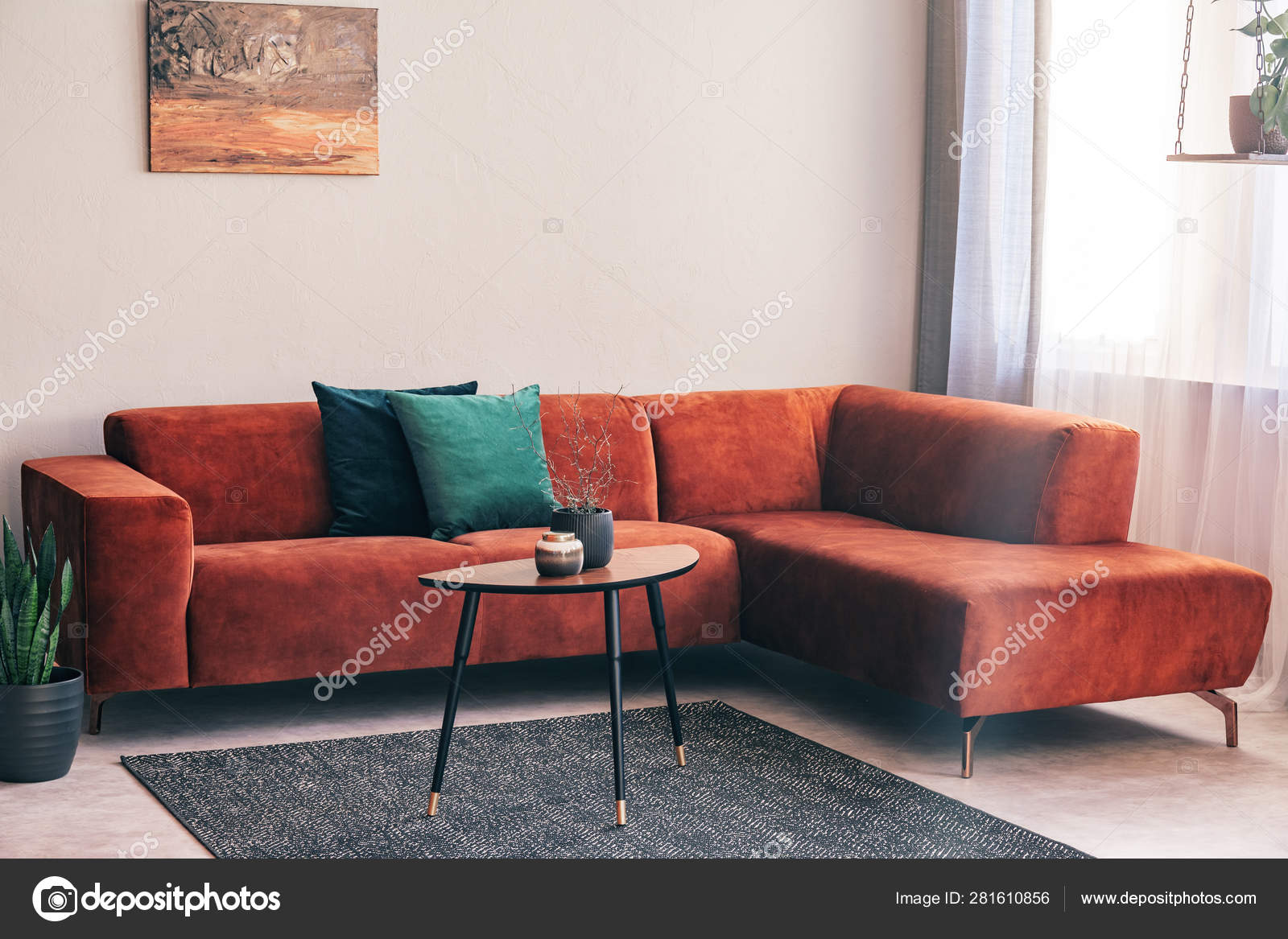 Elegant Small Wooden Coffee Table With Lowers In Front Of Big Velvet Corner Sofa With Pillows Stock Photo Image By Photographee Eu 281610856