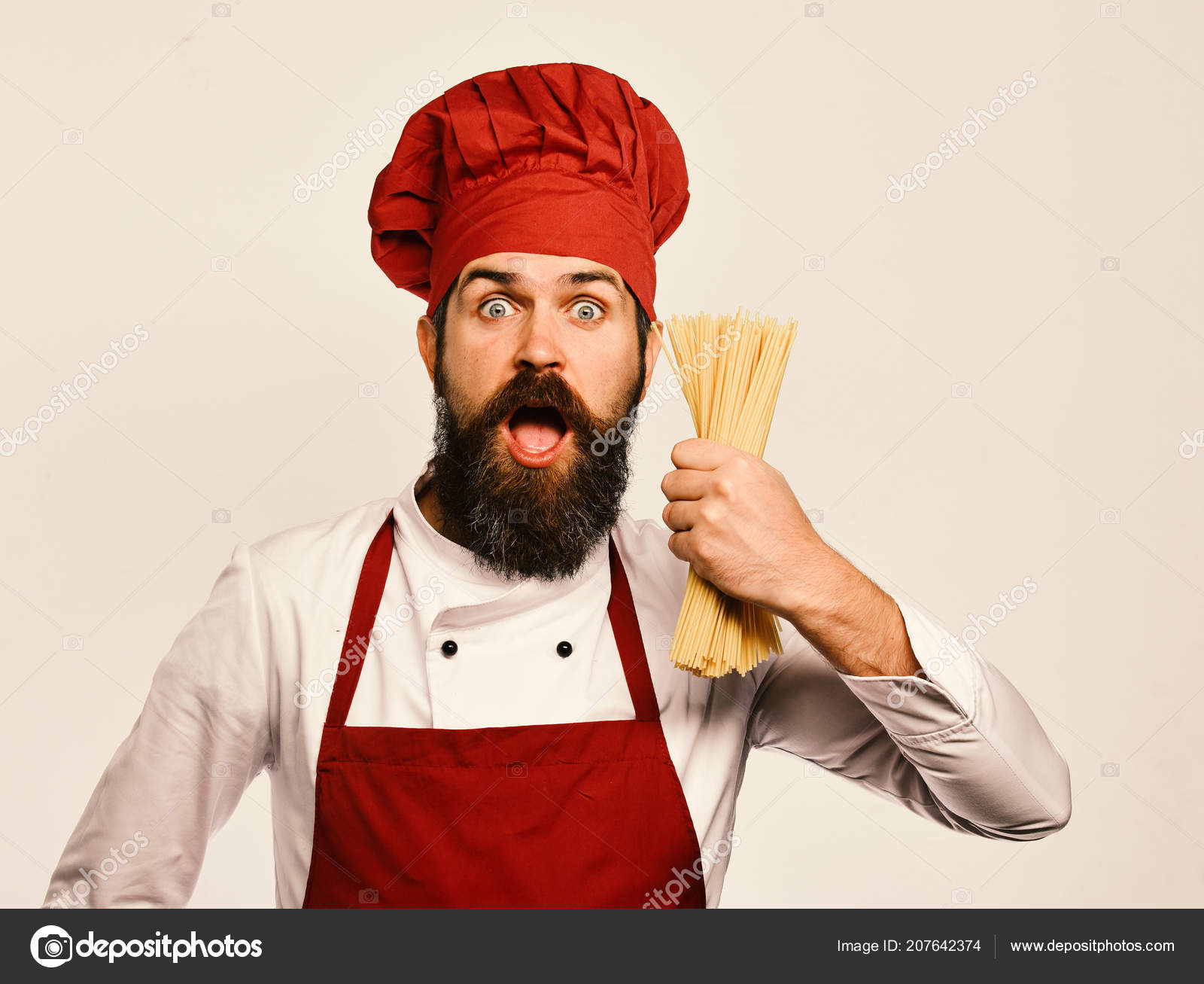 Stock Cuisine Saint Priest Cook With Surprised Face In Burgundy Uniform Holds Dry Pasta