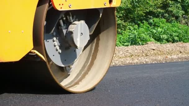 close-up, Road construction works with roller compactor machine - asphalting machine