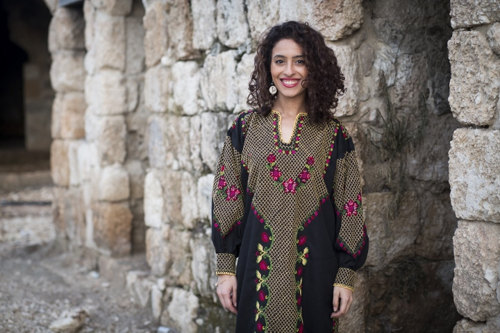 A dress is more than just a piece of clothing, it seems, especially if it is antique and carries the history and struggle of an entire nation, the hard work of women, and great happiness. Photo by Oren Ziv